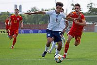3rd September 2021; Newport, Wales:  Jadel Katongo 7 England breaks past Luke Harris of Wales during the U18 International Friendly match between Wales and England at Newport Stadium in Newport, Wales.