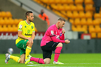 3rd October 2020; Carrow Road, Norwich, Norfolk, England, English Football League Championship Football, Norwich versus Derby; Wayne Rooney of Derby County and Marco Stiepermann of Norwich City take a knee before kick off