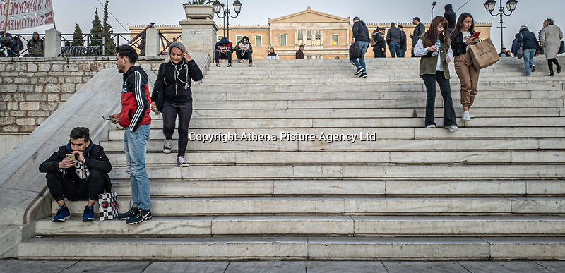 Pictured: On the steps at Syntagma Square.<br /> Re: Street photography, Athens, Greece. Thursday 27 February 2020