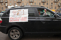 Moscow, Russia, 26/02/2012..A car in a motorcade decorated with anti-Putin slogans. Tens of thousands of people formed a 16-kilometre [10-mile] human chain along Moscow's Garden Ring Road in the latest protest against Prime Minister Vladimir Putin and his presidential election campaign. Opposition activists estimated that they needed 34,000 people to complete the chain and symbolically encircle central Moscow.