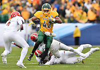 Jacksonville State's defensive lineman Kameron Wood (86) and safety DeBarriaus Miller (31) tackle North Dakota State's running back Bruce Anderson (42) during NCAA Division I Football Championship, in Frisco, Tex. Saturday, January 09, 2016. North Dakota State defeated Jacksonville State 37-10 to win fifth consecutive FCS Championship. (TFV Media via AP) ** Mandatory Credit **