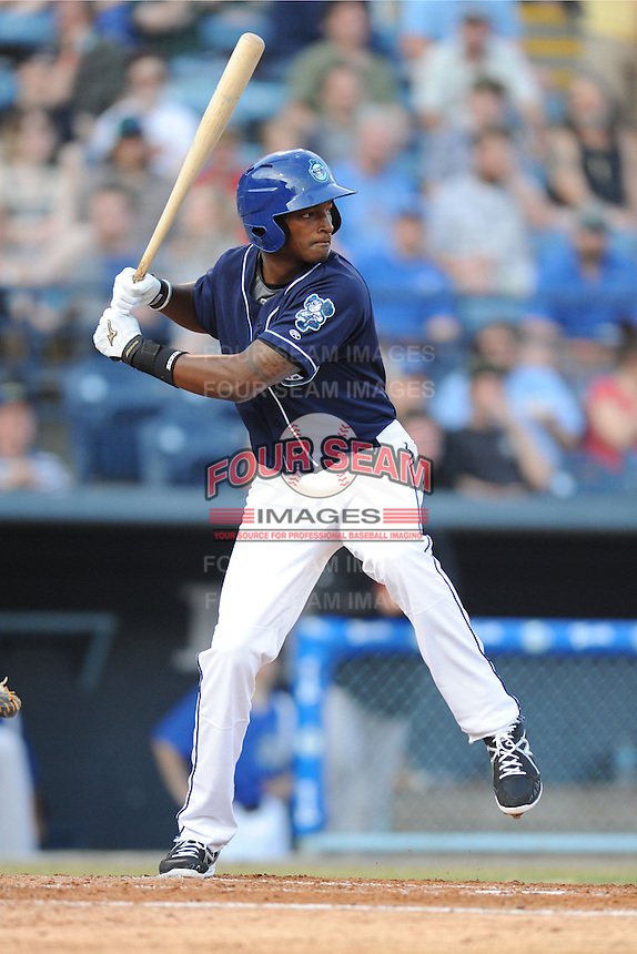 Asheville Tourists first baseman Correlle Prime #32 swings at a pitch during opening night game against the Delmarva Shorebirds at McCormick Field on April 3, 2014 in Asheville, North Carolina. The Tourists defeated the Shorebirds 8-3. (Tony Farlow/Four Seam Images)