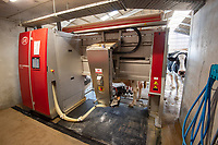 A robotic milking machine in a cubicle house, Gloucestershire.