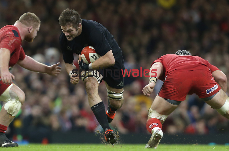 All Blacks captain Richie McCaw charges at Wales pair Samson Lee and Dan Lydiate<br /> Dove men Series 2014<br /> Wales v New Zealand<br /> 22.11.14<br /> ©Steve Pope -SPORTINGWALES