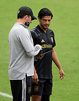 LOS ANGELES, CA - OCTOBER 25: Carlos Vela #10 and Assistant  coach Kenny Arena of the Los Angeles Football Club during a game between Los Angeles Galaxy and Los Angeles FC at Banc of California Stadium on October 25, 2020 in Los Angeles, California.