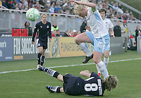 Sonia Bompastor #8 of the Washington Freedom is knocked down by Frida Ostberg #18 of the Chicago Red Stars during a WPS match at Maryland Soccerplex on April 11 2009, in Boyd's, Maryland. The game ended in a 1-1 tie