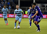 KANSAS CITY, KS - APRIL 23: Johnny Russell #7 of Sporting Kansas City attempts to get away from Kyle Smith #24 of Orlando City SC during a game between Orlando City SC and Sporting Kansas City at Children's Mercy Park on April 23, 2021 in Kansas City, Kansas.