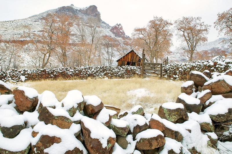 Stone corralwith snow and barn. Near Owyhee River, Oregon