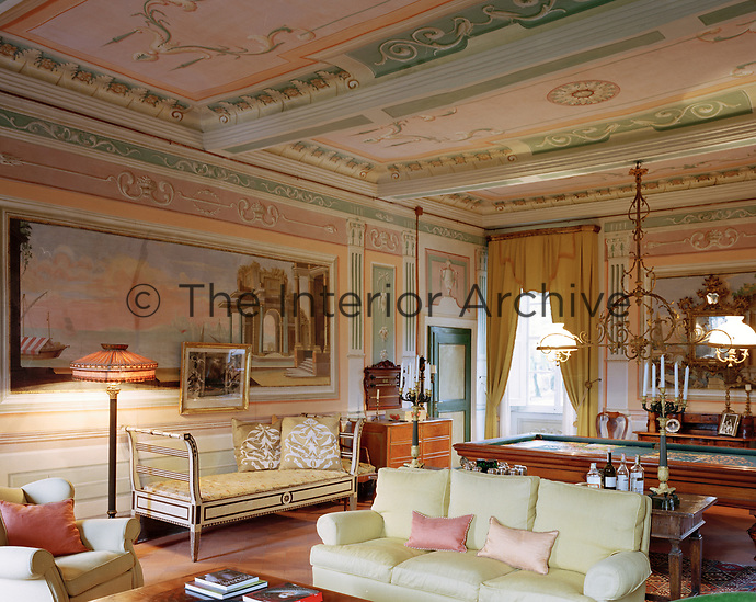With windows facing both north and south, the neoclassical-styled living room on the first floor features early 19th-century trompe l'oeil murals and ceiling