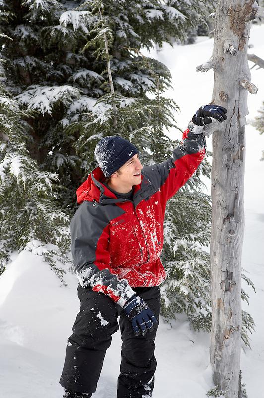Man near Timberline Lodge in winter with Mt. Hood.Oregon