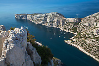 Famous Calanques National Park aerial view, with fishing boats and yachts on the turquoise Mediterranean Sea, French Riviera (Côte d'Azur) France
