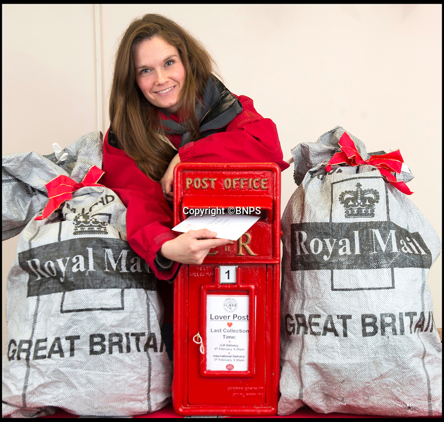 BNPS.co.uk (01202 558833)<br /> Pic: TomWren/BNPS<br /> <br /> Katie Small from the Lover Community Trust post a Valentine's card at the pop-up post office.<br /> <br /> A British village is cashing in on the cupid effect this Valentine's Day by launching its own postal service so anyone can send a card from the 'world's most romantic village'.<br /> <br /> The tiny village of Lover in Wiltshire has launched the 'Lover Post' with limited edition cards and a special post mark showing it has been sent from the tender-hearted village.<br /> <br /> The quirky gimmick is part of a campaign to save the once-thriving village for the local community.