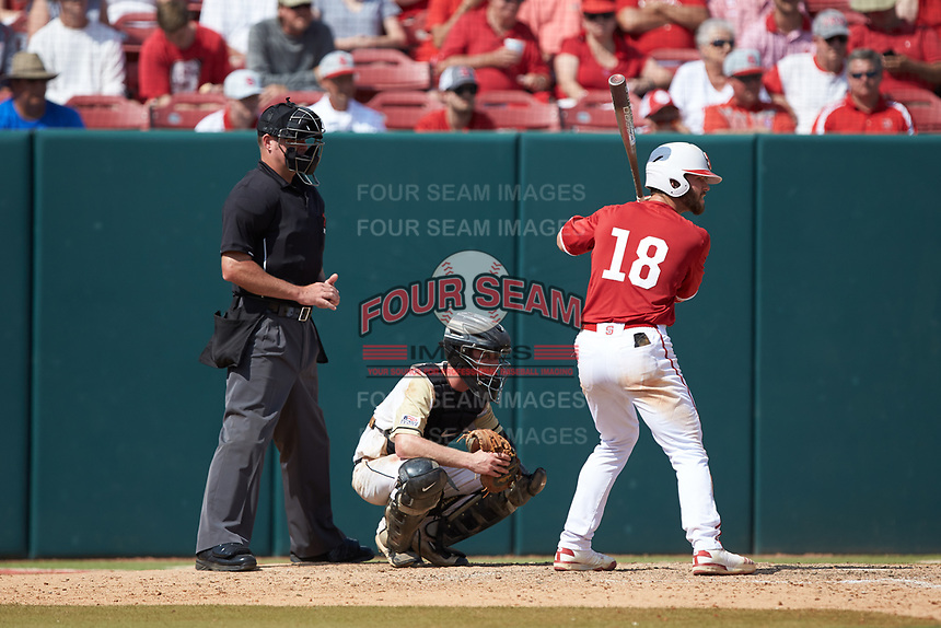 Evan Edwards (18) of the North Carolina State Wolfpack at bat as Army Black Knights catcher Jon Rosoff (7) and home plate umpire Mike Jarboe wait for the pitch at Doak Field at Dail Park on June 3, 2018 in Raleigh, North Carolina. The Wolfpack defeated the Black Knights 11-1. (Brian Westerholt/Four Seam Images)