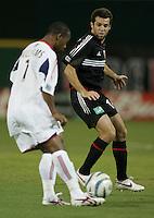 August 31, 2005: Washington, DC, USA:  .DC United midfielder Ben Olsen (14) keeps a close eye on Real Salt Lake midfielder Andy Willaims (7) at RFK Stadium  (c) Copyright 2005 Brad Smith.