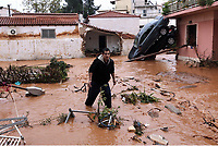 Pictured: A local man walks through a flooded road.<br /> Re: Five people have reportedly died and severe damage caused by heavy rain and flash flooding in the area of Mandra, near Athens, Greece. Wednesday 15 November 2017