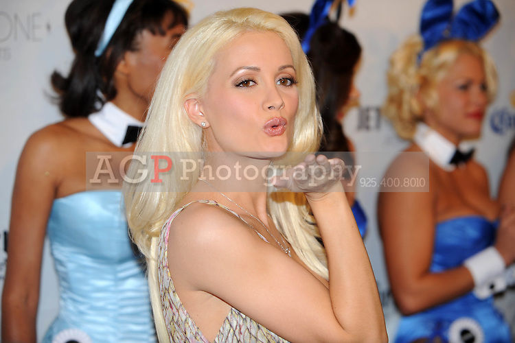 """Holly Madison, star of """"The Girls Next Door"""" poses on the red carpet at Playboy's ninth annual """"Super Saturday Night""""  party in at Playboy's Desert Oasis and Resort in Chandler, Arizona Saturday February 2, 2008.   (Photo by Alan Greth)"""