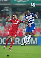24 July 2010:   FC Dallas forward/midfielder Atiba Harris #16 and Toronto FC forward Dwayne De Rosario #14 in action during a game between FC Dallas and Toronto FC at BMO Field in Toronto..The final score was a 1-1 draw...