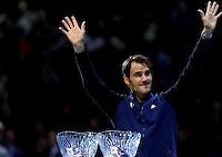 Roger Federer of Switzerland receives the Stefan Edberg Sportsmanship award and the ATPWorldTour.com Fans' Favourite Award at the ATP World Tour Finals, The O2, London, 2015