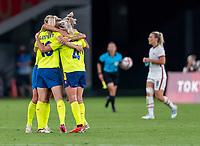 TOKYO, JAPAN - JULY 21: Filippa Angeldal #16 and Hanna Glas #4 of Sweden celebrate after a game between Sweden and USWNT at Tokyo Stadium on July 21, 2021 in Tokyo, Japan.