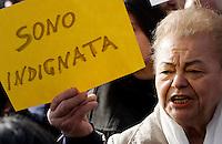 """""""Se non ora quando?"""": manifestazione contro il presidente del consiglio, per il rispetto della dignita' e dei diritti delle donne, a Roma, 13 febbraio 2011..Women attend the """"If not now, when?"""" rally against the Italian premier, to ask for respect of their dignity and rights, in Rome, 13 february 2011..The sign reads """"I am indignant""""..UPDATE IMAGES PRESS/Riccardo De Luca"""
