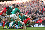 Wales wing George North is hauled down by Ireland flanker Peter O'Mahony..RBS 6 Nations.Wales v Ireland.Millennium Stadium.02.02.13.©Steve Pope-SPORTINGWALES