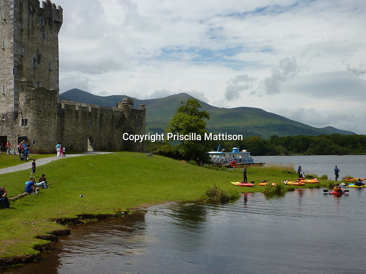 County Kerry, Republic of Ireland - July 19, 2010:  Kayakers assemble on the shore of Lough Leane, next to Ross Castle in Killarney National Park.