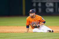 Houston Astros second baseman Jose Altuve (27) on the ground during the MLB baseball game against the Detroit Tigers on May 3, 2013 at Minute Maid Park in Houston, Texas. Detroit defeated Houston 4-3. (Andrew Woolley/Four Seam Images).