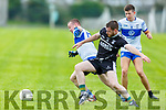 Ardferts Kieran O'Regan tackles Neilus Lyons of  Castleisland Desmonds for possession in division 2 of the County Football league.