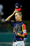 July 25, 2015 : Hiroto Nakayama (7) of Japan reacts after hitting German Duarte (10) of Mexico with a pitch in the game between Mexico and Japan during the Cal Ripken World Series at the Ripken Experience powered by Under Armour in Aberdeen, Maryland. Jon Durr/Ripken Baseball/CSM