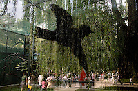 An outline of a bird decorates the side of a glass bird enclosure at the Beijing Zoo in Beijing, China.