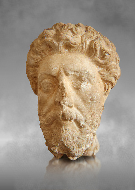 Roman sculpture of the Emperor Marcus Aurelius, excavated  from Carthage made circa 161-180 AD. The Bardo National Museum, Tunis, Inv No: C.965. Against a grey art background.