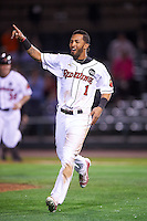 Rochester Red Wings center fielder Eddie Rosario (1) celebrates after scoring the game winning run during a game against the Columbus Clippers on June 14, 2016 at Frontier Field in Rochester, New York.  Rochester defeated Columbus 1-0.  (Mike Janes/Four Seam Images)