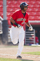 Jared Bolden #15 of the Hickory Crawdads hustles down the first base line against the Greensboro Grasshoppers at  L.P. Frans Stadium July 10, 2010, in Hickory, North Carolina.  Photo by Brian Westerholt / Four Seam Images
