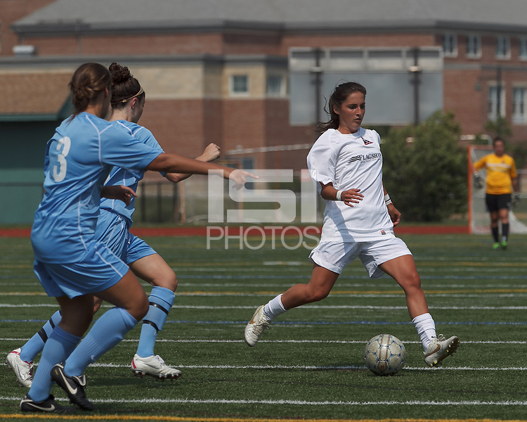 Boston Aztec midfielder Alexa St. Martin (20) passes the ball.  In a Women's Premier Soccer League (WPSL) match, Boston Aztec (white) defeated Seacoast United Mariners (blue), 2-1, at North Reading High School Stadium on Arthur J. Kenney Athletic Field on on June 23, 2013. Due to injuries through the season, Seacoast United Mariners could only field 10 players.