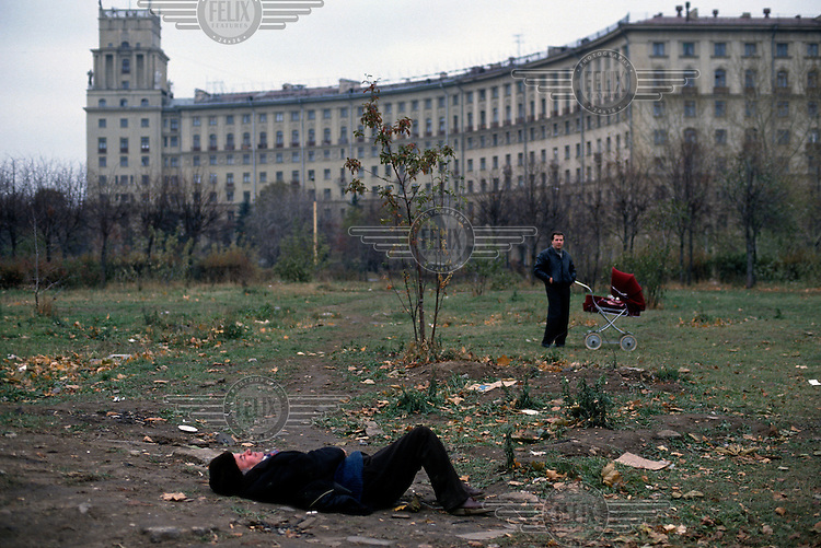 A drunken man passed out in a park after a little too much vodka.