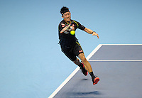 Kei Nishikori (JPN) in action against Novak Djokovic (SRB) during Day One of the Barclays ATP World Tour Finals 2015 played at The O2, London on November 15th 2015