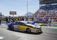 Apr 12, 2015; Las Vegas, NV, USA; NHRA pro stock driver Allen Johnson (near lane) races alongside Vincent Nobile during the Summitracing.com Nationals at The Strip at Las Vegas Motor Speedway. Mandatory Credit: Mark J. Rebilas-