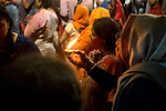 A woman offers a lamp to Lord Krishna during worship on the occassion of Holi Festival in Vrindavan. Holi - The  Hindu festival of colour is celibrated for a week in the Brraj region of Uttar Pradesh, India.