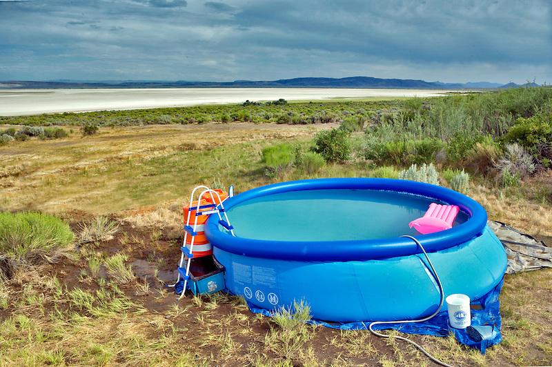 Small plastic swimming pool on the edge of the Alvord Desert. Oregon