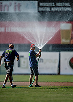 20 June 2021: Members of the Vermont Lake Monsters Grounds Crew irrigate the infield dirt prior to a game against the Westfield Starfires at Centennial Field in Burlington, Vermont. The Lake Monsters fell to the Starfires 10-2 at Centennial Field, in Burlington, Vermont. Mandatory Credit: Ed Wolfstein Photo *** RAW (NEF) Image File Available ***