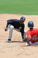 GCL Twins second baseman Jonatan Ninojosa (41) tags Joseph Monge (41) sliding in during a game against the GCL Red Sox on July 19, 2013 at JetBlue Park at Fenway South in Fort Myers, Florida.  GCL Red Sox defeated the GCL Twins 4-2.  (Mike Janes/Four Seam Images)