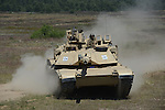 "An American M1A2 Abrams tank during a tank maneuver training exercise where Americans and Danes worked together to simulate battle against opposing forces at the Drawsko Pomorskie Training Area in Poland on June 11, 2015.    NATO is engaged in a multilateral training exercise ""Saber Strike,"" the first time Poland has hosted such war games, involving the militaries of Canada, Denmark, Germany, Poland, and the United States."