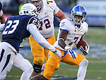 San Jose State's Tyler Ervin runs against Nevada defender Dameon Baber during overtime in an NCAA college football game in Reno, Nev., on Saturday, Nov. 14, 2015. Nevada won 37-34. San Jose State's Wes Schweitzer is at rear. (AP Photo/Cathleen Allison)