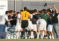Players of Georgetown University after Uche Oteqbeye #9 had scored the winning goal during an NCAA match against Northeastern University at North Kehoe Field, Georgetown University on September 3 2010 in Washington D.C. Georgetown won 2-1 AET.
