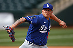 Victor Gonzalez pitches during a spring training game between the Texas Rangers and Los Angeles Dodgers in Surprise, Ariz., on Sunday, March 7, 2021.<br /> Photo by Cathleen Allison