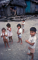 Envirormental portriat of Amazon Basin, Peruvian  children living in the slums of Belen, on the bank on the Ucayali River.