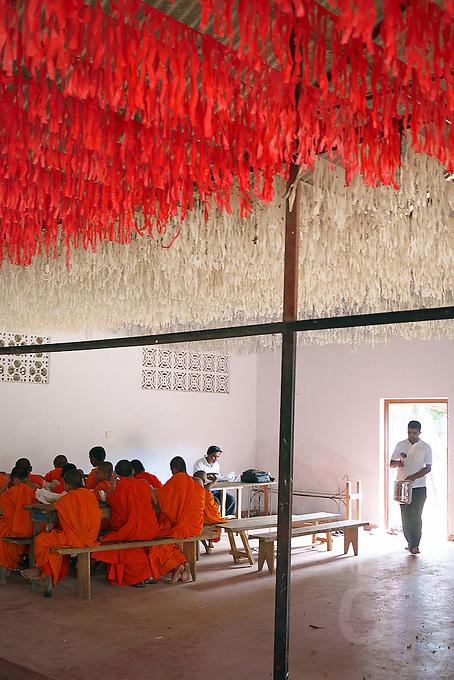 Monks having their 11 o'clock break at a Monastery near Dambulla,Sri Lanka.
