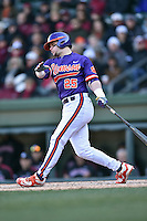 Clemson Tigers catcher Chris Okey (25) swings at a pitch during a game against the South Carolina Gamecocks at Fluor Field February 28, 2015 in Greenville, South Carolina. The Gamecocks defeated the Tigers 4-1. (Tony Farlow/Four Seam Images)