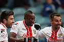 Lucas Akins of Stevenage (c) celebrates after scoring the winning goal with Michael Doughty (l) and Filipe Morais<br />  - Peterborough United v Stevenage - Sky Bet League One - London Road, Peterborough - 23rd November 2013. <br /> © Kevin Coleman 2013