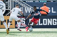 FOXBOROUGH, MA - MARCH 7: Cristian Penilla #70 of New England Revolution breaks left as Francisco Calvo #5 of Chicago Fire defends during a game between Chicago Fire and New England Revolution at Gillette Stadium on March 7, 2020 in Foxborough, Massachusetts.